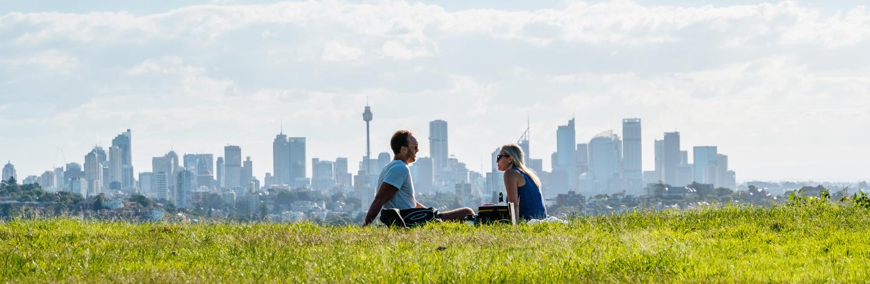 Couple Sitting On Field