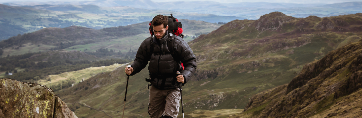 Young Male Hiker Moving Up Mountain, The Lake District, Cumbria, Uk